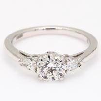 Fuji pear and round cut white diamond 3 stone engagment ring