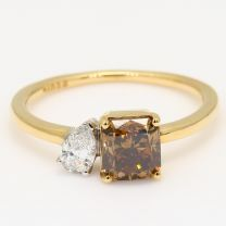 Genesis radiant cut champagne and pear cut white diamond ring