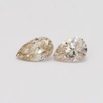0.82 Total carat pair of pear cut light champagne diamonds