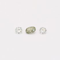 0.13 Total carat trio of oval and round cut green and white diamonds