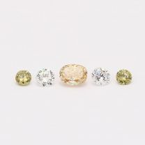 0.25 Total carat parcel of oval and round cut orange green and white diamonds